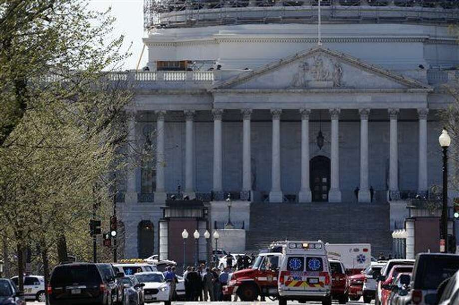 Law Enforcement and rescue vehicles are seen on Capitol Hill in Washington, Monday, March 28, 2016, after a U.S. Capitol Police officer was shot at the Capitol Visitor Center complex, and the shooter was taken into custody. Photo: AP Photo/Alex Brandon