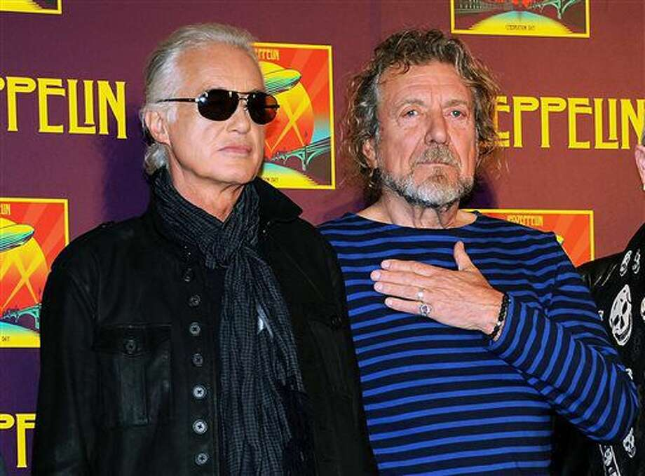 "FILE - In this Oct. 9, 2012 file photo, Led Zeppelin guitarist Jimmy Page, left, and singer Robert Plant appear at a press conference ahead of the worldwide theatrical release of ""Celebration Day,"" a concert film of their 2007 London O2 arena reunion show, in New York. Led Zeppelin's lawyers asked a judge Monday, June 20, 2016, to throw out a case accusing the band's songwriters of ripping off a riff for ""Stairway to Heaven."" Photo: Photo By Evan Agostini/Invision/AP, File"