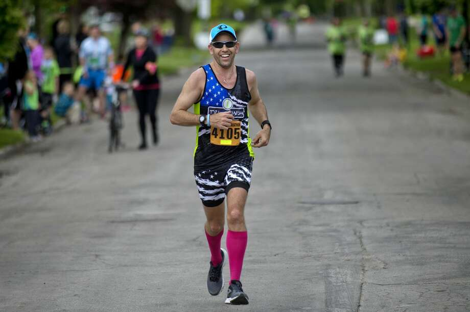 Jason Lafave, overall winner of the half marathon, approaches the finish line on Mill Street during the Dow RunWalk on Saturday. Photo: NICK KING | Nking@mdn.net