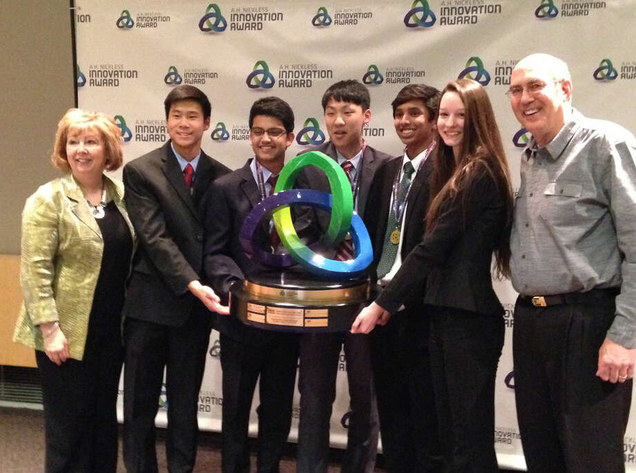 H.H. Dow High School Principal Pam Kastl, left, and team mentor Charlie Nielsen, right, pose with team members Andrew Wong, Satyajit Sarkar, Austen Zhu, Varun Shanker and Madison Kent. Photo: Photo Provided