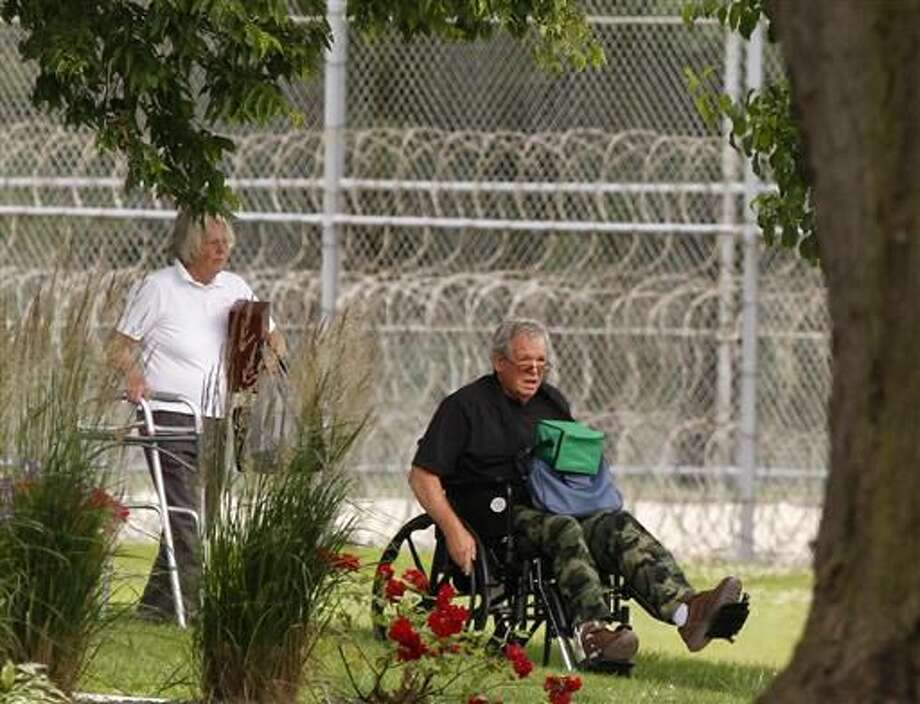 Former Speaker of the House Dennis Hastert, right, reports to the Federal Medical Center in Rochester, Minn., on Wednesday, June 22, 2016, to begin serving a 15-month sentence in a hush money case. Photo: Andrew Link/The Rochester Post-Bulletin Via AP