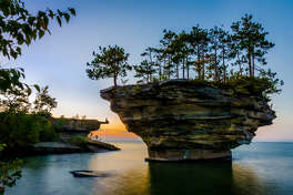 MICHIGAN: TURNIP ROCKThis fascinating rock formation off the coast of Port Austin, Michigan, came to be after many years of waves wore down the stone. The land surrounding Turnip Rock is privately owned; however, so the only way to get up close and personal with the island is via water. Note that the area is especially shallow, so stepping out of a kayak to take a beautiful photo like this one is doable.