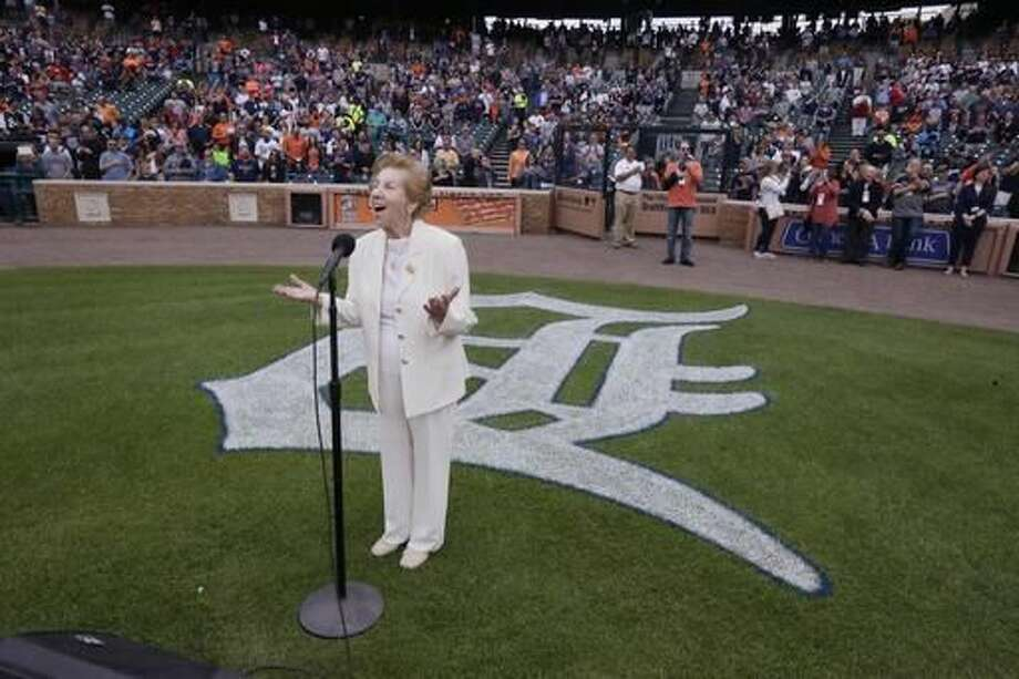 Hermina Hirsch, 89, a Holocaust survivor, sings the national anthem before the baseball game between the Detroit Tigers and the Tampa Bay Rays, Saturday, May 21, 2016, in Detroit. Hirsch's bucket list included singing the anthem before a Tigers game. Photo: AP Photo/Carlos Osorio