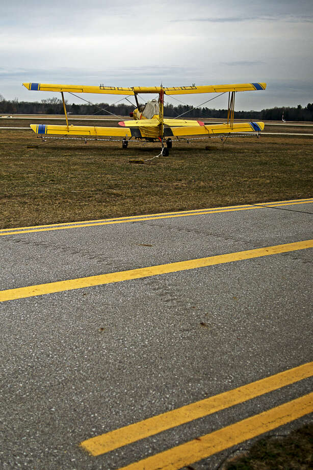A plane waits to be tested for calibration before taking off to distribute mosquito larvicide treatment in this Daily News file photo. Midland County residents will go to the polls on Aug. 2 to vote on a millage renewal for mosquito control. Photo: Erin Kirkland |  Daily News File Photo