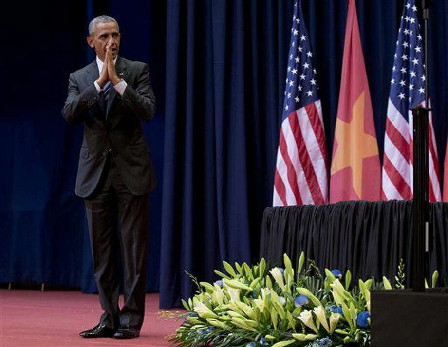 U.S. President Barack Obama bows as he leaves the stage after speaking at the National Convention Center in Hanoi, Vietnam, Tuesday, May 24, 2016. After knocking down one of the last vestiges of Cold War antagonism with a former war enemy, Obama on Tuesday took his push for closer ties directly to the Vietnamese people, meeting with activists and entrepreneurs and arguing that better human rights would boost the communist country's economy, stability and regional power. (AP Photo/Carolyn Kaster) Photo: Carolyn Kaster