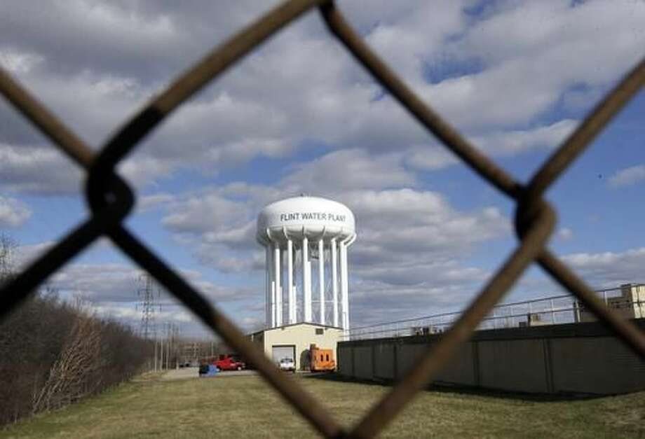FILE - This March 21, 2016 file photo shows the Flint Water Plant water tower in Flint, Mich. Michigan Gov. Rick Snyder is calling for a halt of administrative investigations into how two state agencies dealt with the Flint drinking water crisis after being warned they are hampering state and federal criminal probes. Snyder's office released letters Thursday May 26, 2016, from the state attorney general and a federal prosecutor. (AP Photo/Carlos Osorio File) Photo: Carlos Osorio
