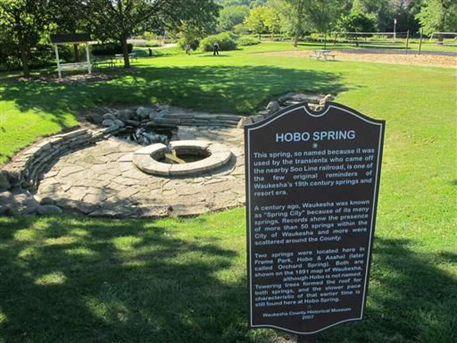 This Sept. 12, 2013 file photo shows Hobo Spring in Waukesha, Wis. It was among many springs in the city that once provided most of Waukesha's drinking water. Representatives of the eight states in the Great Lakes region approved a Wisconsin city's request to tap Lake Michigan as its drinking water source Tuesday June 21, 2016 in Chicago. Waukesha says its groundwater is contaminated with radium. The city is only 17 miles from the lake. But because it lies just outside the Great Lakes watershed, it needed permission from all the region's states to use Lake Michigan water. (AP Photo/John Flesher, File)