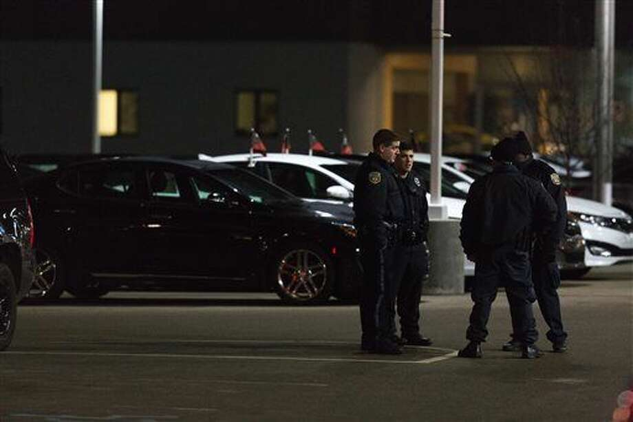 Police are shown in the parking lot of a car dealership, after a random shooting on Sunday in Kalamazoo. Jason Dalton of Kalamazoo County was arrested early Sunday in downtown Kalamazoo following a massive manhunt after several victims were shot at random.