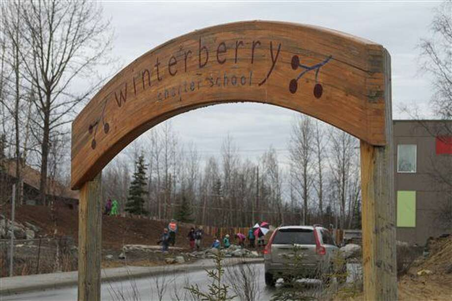 Children play outside Winterberry Charter School in Anchorage, Alaska, Wednesday. Three first-graders in Alaska's largest city plotted to kill a fellow student with silica gel packets that the girls believed was poison and have been disciplined but not charged with any crime, authorities said Wednesday. Photo: Mark Thiessen | AP Photo