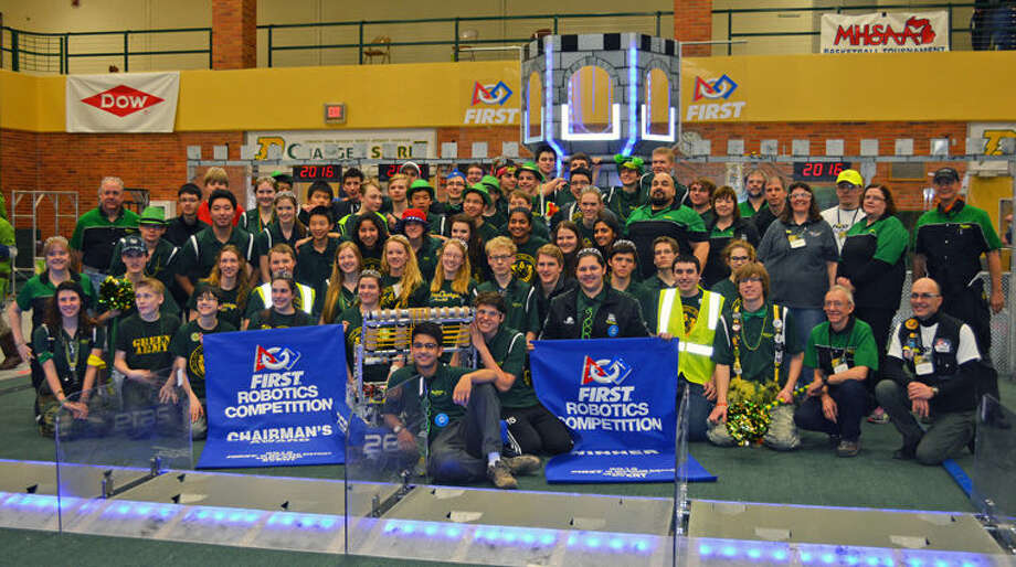 Members of the Dow High FIRST Robotics Team 2619, The Charge, appear with their robot after their win. Photo: Photo Provided