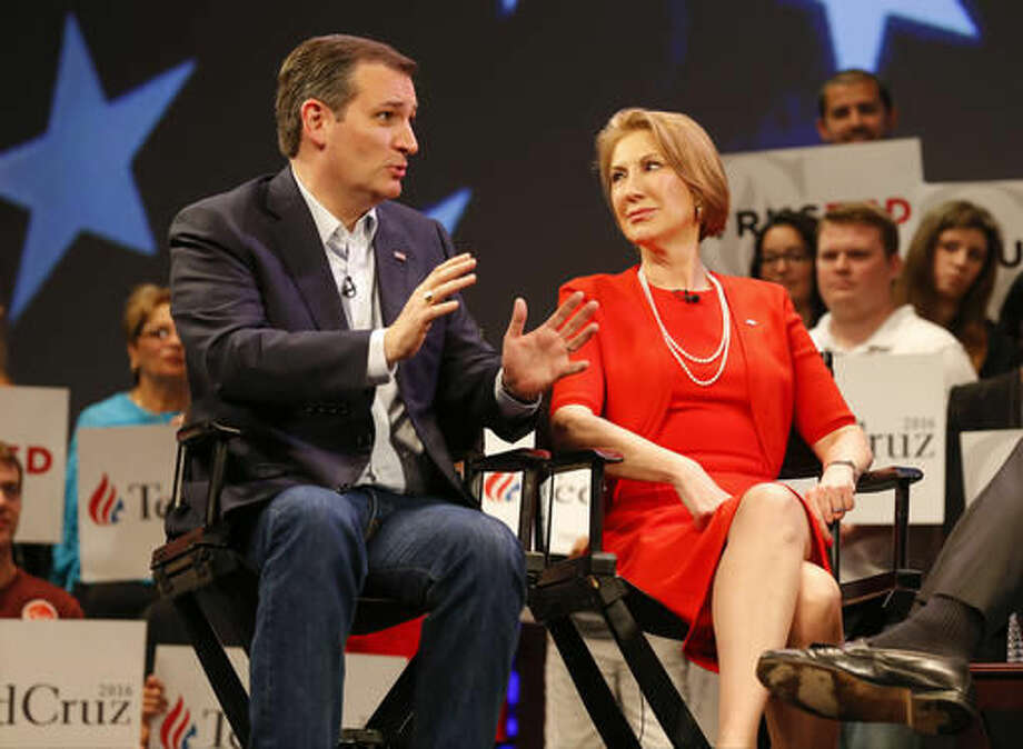 In this photo taken March 11, Republican presidential candidate Sen. Ted Cruz, R-Texas, speaks to Carly Fiorina in Orlando, Fla. According to an AP Source: Cruz has picked Fiorina as his running mate. Photo: AP Photo