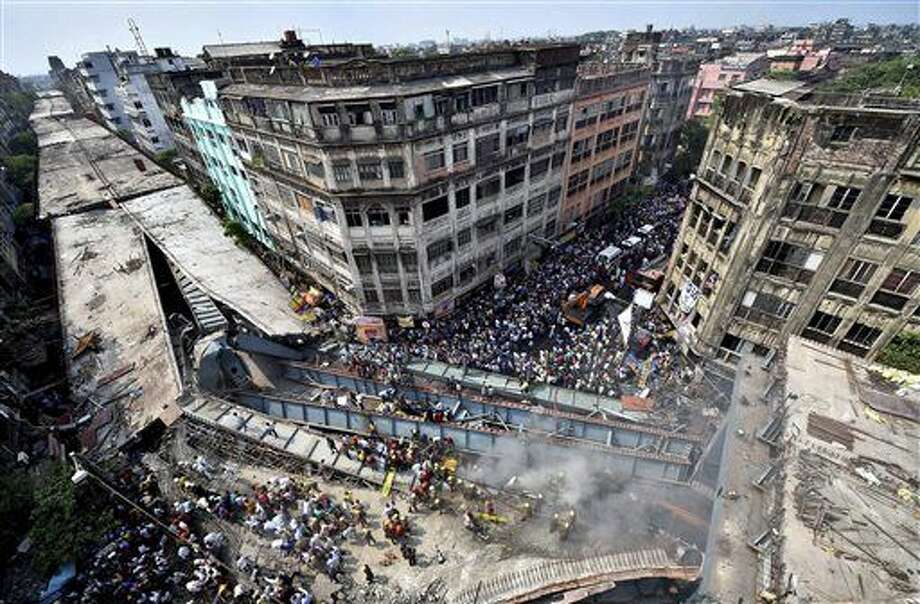 Locals and rescue workers clear the rubbles of a partially collapsed overpass in Kolkata, Thursday, March 31, 2016. Rescuers dug through large chunks of debris from the overpass that collapsed while under construction Thursday, killing many people and injuring scores of others, officials said. (Swapan Mahapatra/Press Trust of India via AP) INDIA OUT, CREDIT MANDATORY Photo: Swapan Mahapatra