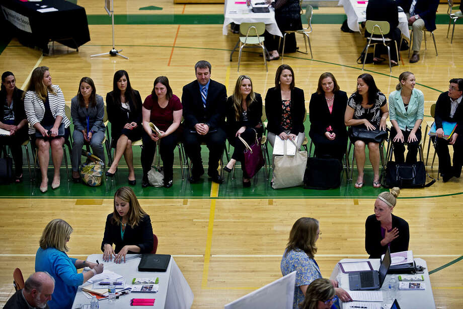 Candidates wait to talk to recruits at a job fair hosted by the Midland Public Schools on Tuesday at H.H. Dow High School. At the end of the school year, 46 teachers are retiring. Photo: Erin Kirkland | Midland Daily News
