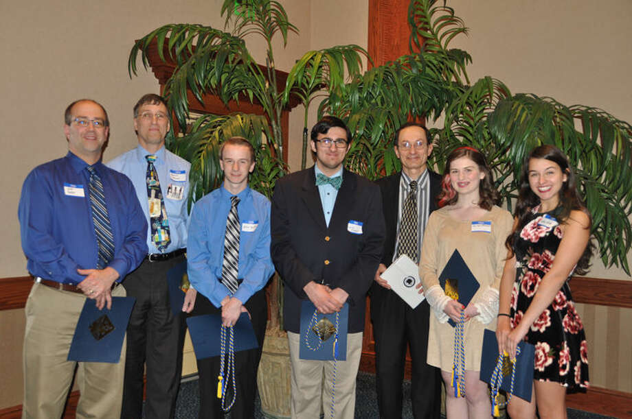 High school teachers and students are shown at the 2016 Recognition Banquet. From left to right are Midland High teacher Jeff Yoder, Saginaw Arts and Science Academy teacher Dr. David Allan, John Smith and James Shepich of Saginaw Arts and Science Academy, Chemistry Olympiad committee chair Dr. Michael Tulchinsky, Cailynn Aumock of Bay City Western High School and Laken Rivet of John Glenn High School. Photo: Photo Provided