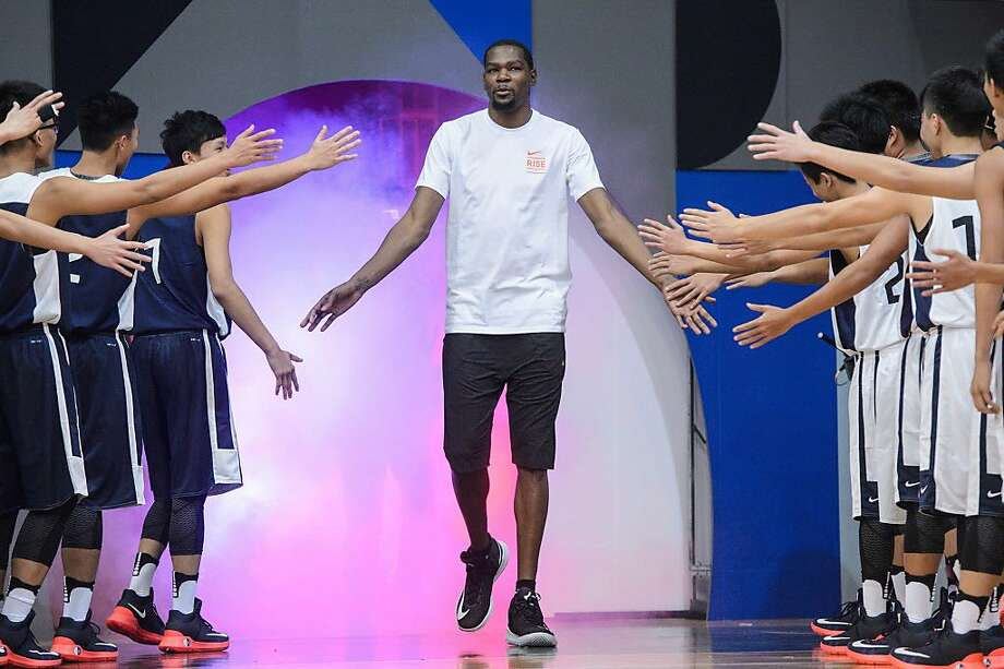Golden State Warrior Kevin Durant  arrives at a Nike promotional event in Hong Kong on July 12, 2016.  Photo: ANTHONY WALLACE, AFP/Getty Images