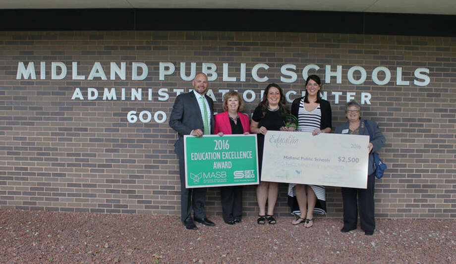 Pictured, from left, are Travis Van Tighem, SET SEG; Pam Kastl, Dow High principal; Sarah Hechlik, Dow High English teacher; Lisa Bonotto, Dow High Spanish teacher; Ruth Coppens, Michigan Association of School Boards Board of Directors member. Photo: Photo Provided