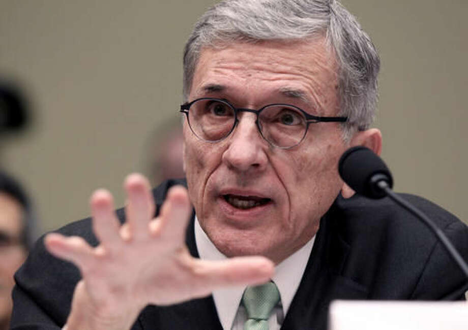 FILE - In this Tuesday, March 17, 2015, file photo, Federal Communications Commission Chairman Tom Wheeler testifies before a House committee hearing on net neutrality, on Capitol Hill in Washington. A program to get low-income Americans federal-government help paying for Internet access is targeted to start in December 2016. The FCC voted, 3-2 along party lines, Thursday, March 31, 2016, to expand the $1.5 billion Lifeline program, a $9.25-a-month subsidy, to Internet as well as phone service. (AP Photo/Lauren Victoria Burke, File) Photo: Lauren Victoria Burke