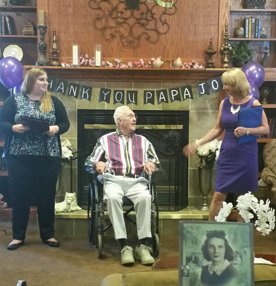 """""""Papa Joe"""" Lubbehusen receives a """"Grand Champion's"""" certificate and a """"Top Fundraiser"""" pin from Betty O'Neill, right, of the Alzheimer's As- sociation, during a reception in his honor on Monday. Kelly Bailiff, event director for the Alzheimer's Association, is on the left. Photo: Photo Provided"""
