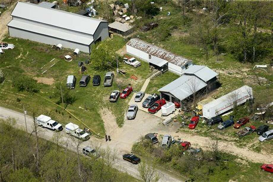 This aerial photo shows one of the locations being investigated in Pike County, Ohio, as part of an ongoing homicide investigation, Friday, April 22, 2016. Several people were found dead Friday at multiple crime scenes in rural Ohio, and at least most of them were shot to death, authorities said. No arrests had been announced, and it's unclear if the killer or killers are among the dead. (Lisa Marie Miller/The Columbus Dispatch via AP) MANDATORY CREDIT Photo: Lisa Marie Miller