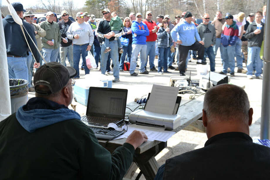 Anglers and spectators watch last year as officials tabulate results of the two-day Freeland Walleye Festival fishing tournament. Photo: Steve Griffin | File Photo For The Daily News