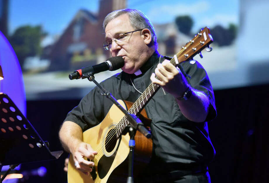 Bishop Cistone plays his guitar at the 2015 MYE Faith Youth Event Photo: Photo Provided