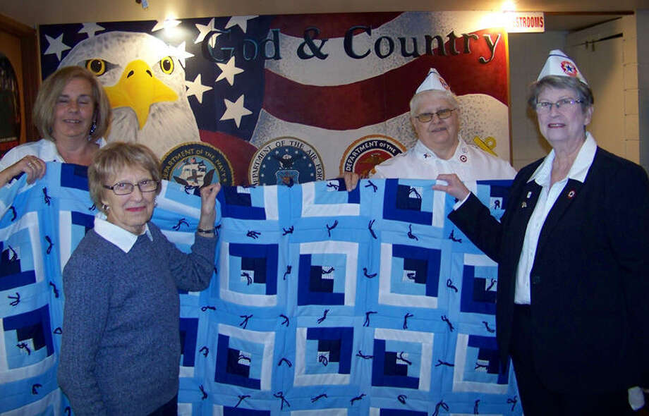 Pictured from left are Deb Baker, Joyce Hepinstall, Audrey Lashuay and Kathy Bate. Hepinstall was presented a king-size quilt from the Blue Star Mothers of Midland County on April 15. Photo: Photo Provided