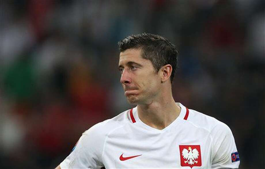 Poland's Robert Lewandowski reacts at the end of the Euro 2016 quarterfinal soccer match between Poland and Portugal, at the Velodrome stadium in Marseille, France, Thursday, June 30, 2016. Portugal defeated Poland 5-3 in a penalty shootout after the game ended tied 1-1. (AP Photo/Thanassis Stavrakis) Photo: Thanassis Stavrakis