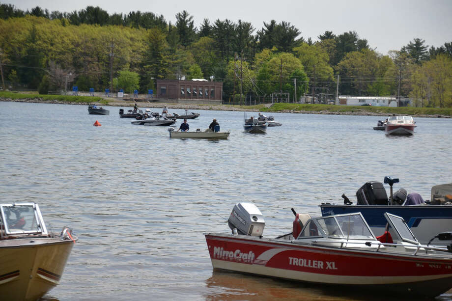 Boats cluster near the dock of the Sanford Lake County Park as Saturday's Northern Pike Charity draws to a close. Photo: Steve Griffin | For The Daily News