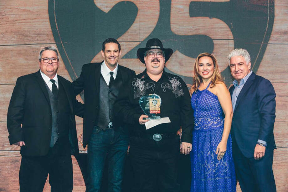 Pictured, from left, are: Cam Campbell, divisional vice president; Tony Wehner, senior vice president of operations; Tom Riordan, general manager, Logan's Roadhouse in Midland; Maria Rivera, executive vice president of operations; Sam Borgese, CEO and president. Photo: Photo Provided