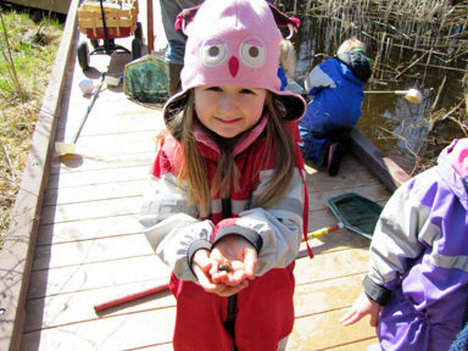 A Nature Preschool student explores the ponds outside at the Chippewa Nature Center. Photo: Photo Provided By CNC