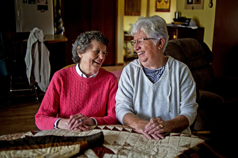 Midland Quilters Squared Quilt Show featured quilters Helen Mudd, left, and Marcia Stanick, right, post for a photo in Stanick's Midland home. Photo: Erin Kirkland/Midland Daily News
