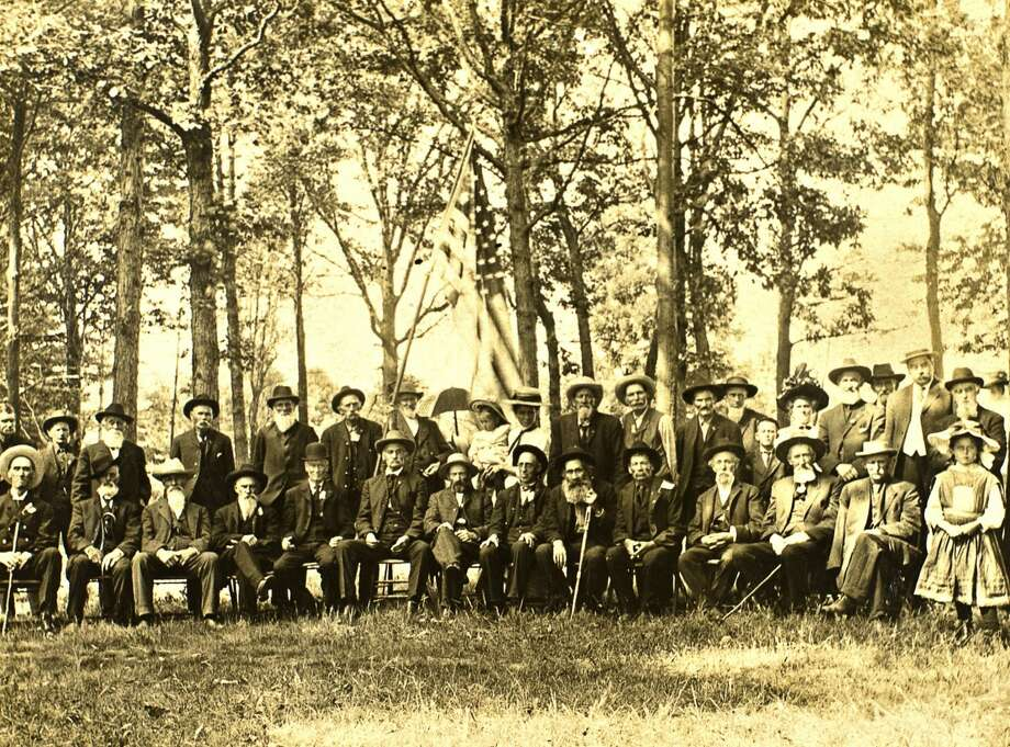 Midland County Historical Society Midland's Dwight D. May Post of the Grand Army of the Republic Civil War veterans pose for a photo on Decoration Day approximately dated in the 1910s. Memorial Day was originally known as Decoration Day and was instituted after the American Civil War by the Grand Army of the Republic. Photo: Midland County Historical Society