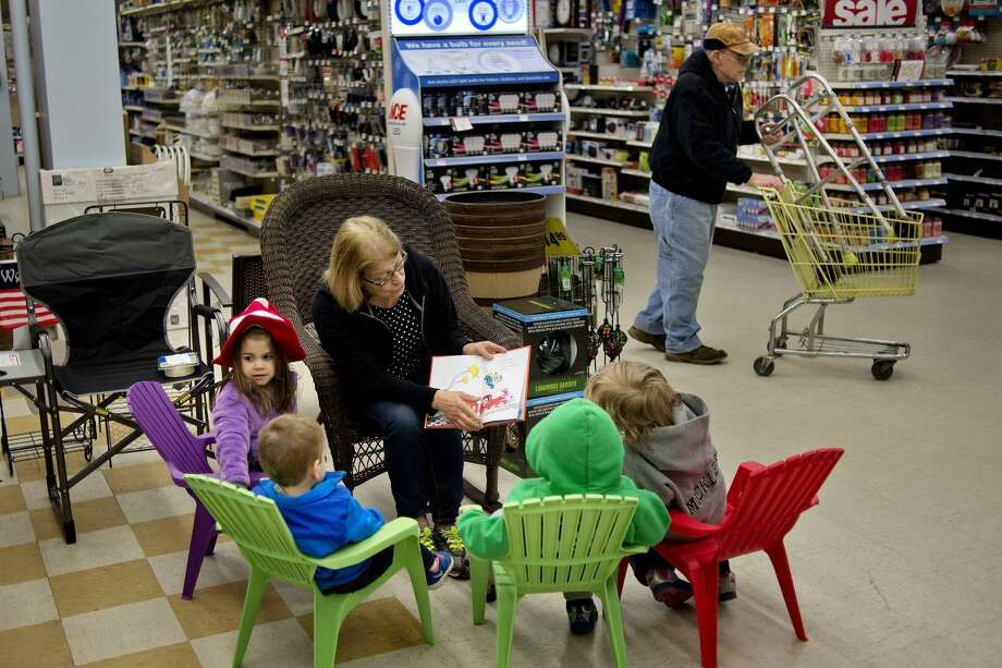 NICK KING | nking@mdn.net Elaine White, center, reads 'Green Eggs and Ham' to, from left, Lilliana, 4, and Lanson Messing, 2, Kayson Stevens and Brantley Mickler, both 4, at Ace Hardware during Downtown Story Day on Saturday in Midland. The Grace A Dow Memorial Library loaned out different Dr. Seussbooks for volunteers to do dramatic readings at downtown businesses. Participating businesses included Ways To Wellness, Pizza Sam's, Imagine That!, Journeys Coffee House, MI Float, Northwood Gallery, Crepes Et Amis, Mr. Moustache, Riverside Place, Mercato di O&V, Heather 'n Holly and Grape Beginnings Winery. Photo: Nick King/Midland Daily News
