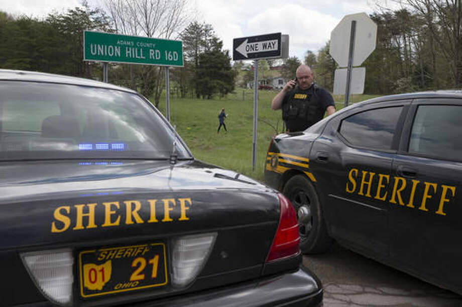 Authorities create a perimeter near a crime scene on Union Hill Rd, Friday, April 22, 2016, in Pike County, Ohio. Shootings with multiple fatalities were reported along a road in rural Ohio on Friday morning, but details on the number of deaths and the whereabouts of the suspect or suspects weren't immediately clear. The attorney general's office said a dozen Bureau of Criminal Investigation agents had been called to Pike County, an economically struggling area in the Appalachian region some 80 miles east of Cincinnati. Photo: AP Photo/John Minchillo