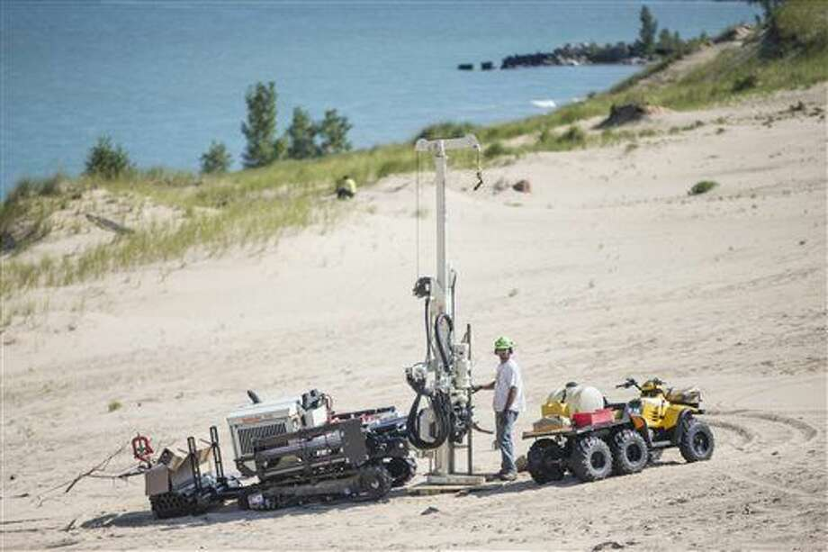 In this Aug. 14, 2014 file photo, a researcher uses large equipment to study Indiana Dunes National Lakeshore's Mount Baldy in Michigan City, Ind. The popular sand dune at the Indiana Dunes National Lakeshore along Lake Michigan will remain closed this summer as scientists study what caused a boy to nearly be buried alive in 2013, a park spokesman said Monday, April 11, 2016. Photo: Robert Franklin/South Bend Tribune Via AP