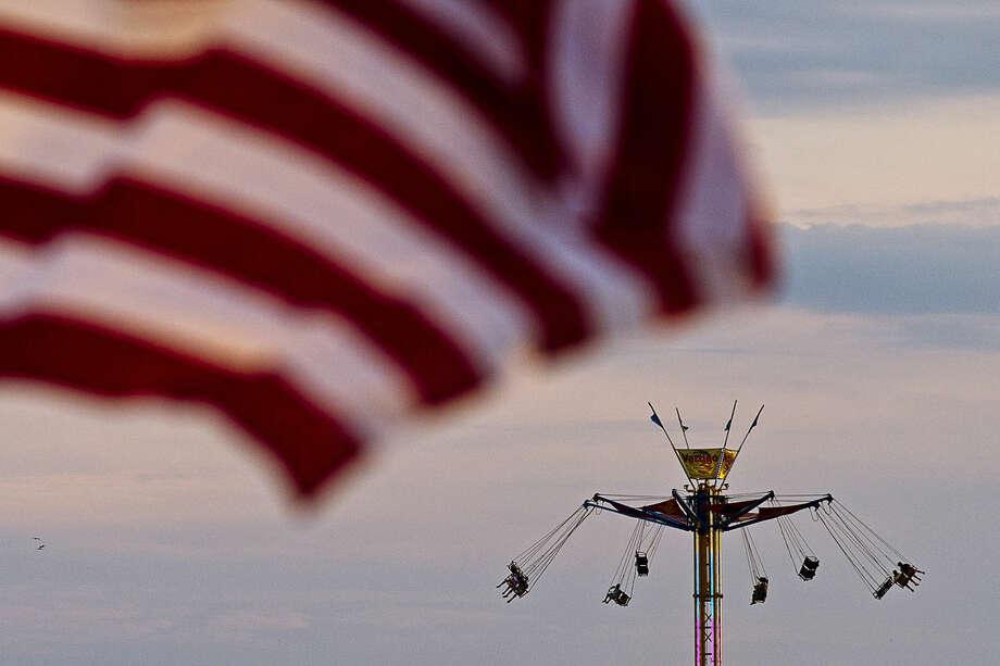 Carnival goers ride Vertigo on Thursday at the Bay City Fireworks Festival. Photo: Erin Kirkland | Midland Daily News