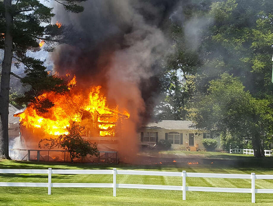 No one was hurt in a blaze that destroyed a pole barn at a Sanford home this afternoon. Photo: Tereasa Nims