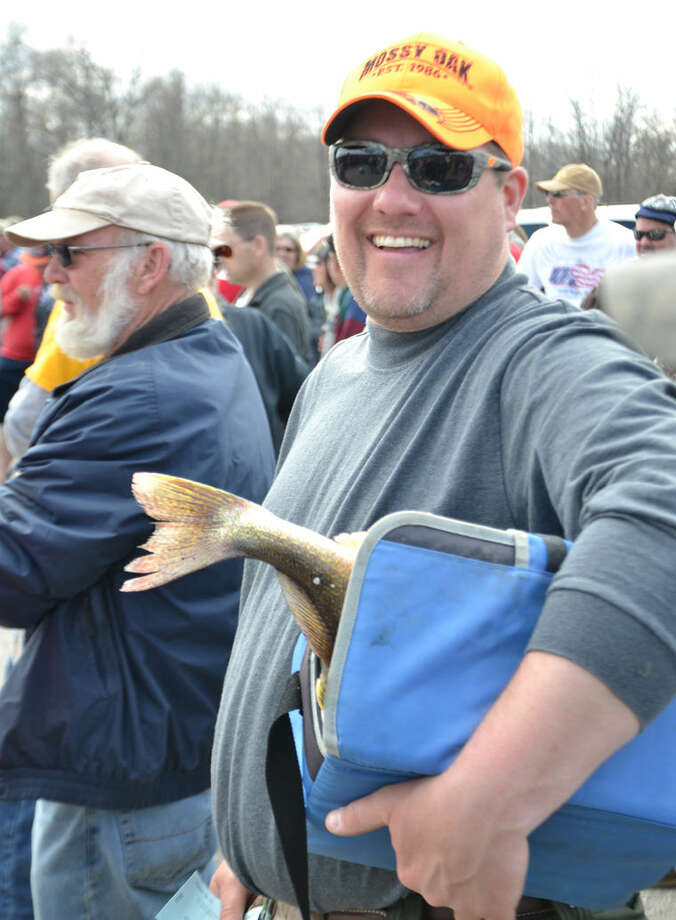 Even if they're not contest winners, opening-weekend walleyes bring smiles to festival and tournament participants. Last year, on the tournament's second day, Branden Kerr of Zilwaukee caught four fish weighing 9.5 pounds. Photo: Steve Griffin | Daily News, File