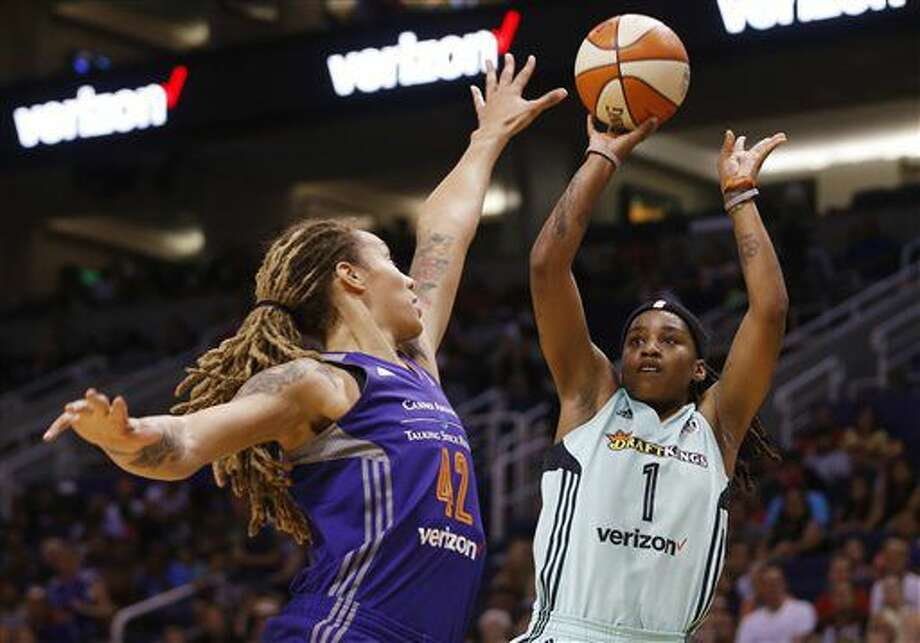 Phoenix Mercury's Brittney Griner (42) jumps to contest a shot from New York Liberty's Shavonte Zellous (1) during the first half of a WNBA basketball game Friday, July 1, 2016, in Phoenix. (Patrick Breen/The Arizona Republic via AP) Photo: Patrick Breen