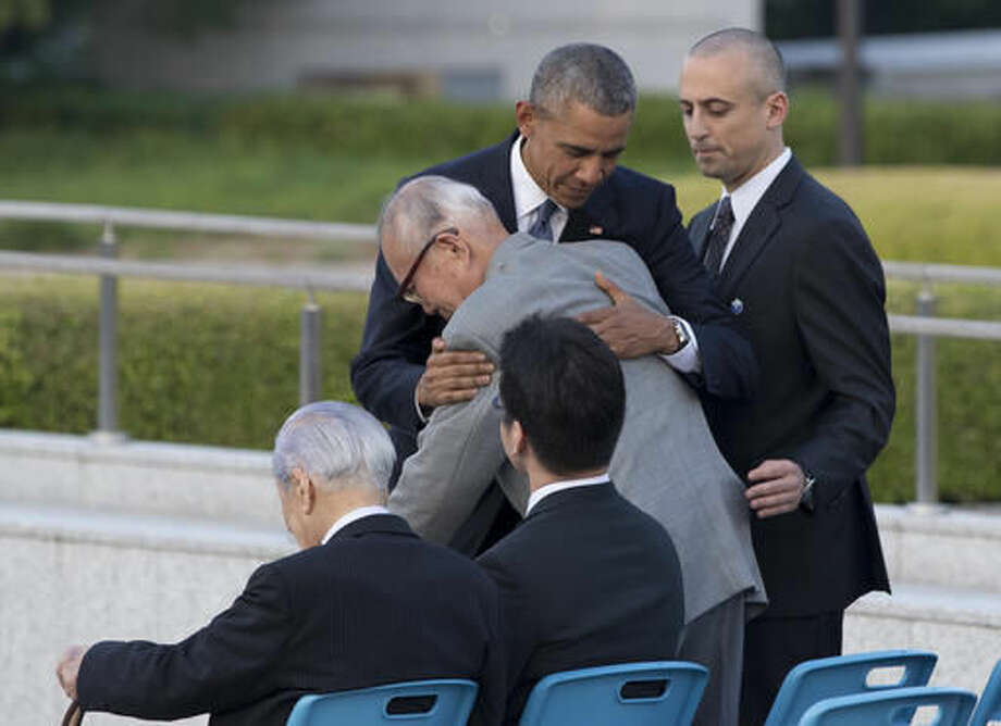 U.S. President Barack Obama hugs Shigeaki Mori, an atomic bomb survivor; creator of the memorial for American WWII POWs killed at Hiroshima, during a ceremony at Hiroshima Peace Memorial Park in Hiroshima, western Japan, Friday, May 27, 2016. Obama on Friday became the first sitting U.S. president to visit the site of the world's first atomic bomb attack, bringing global attention both to survivors and to his unfulfilled vision of a world without nuclear weapons. (AP Photo Carolyn Kaster) Photo: Carolyn Kaster