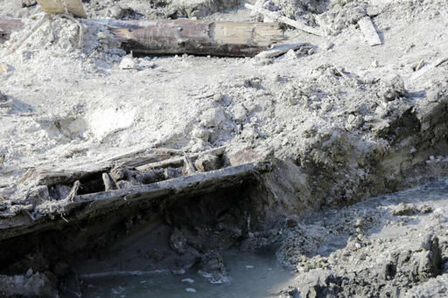 A portion of a shipwreck from the 1800s that has been uncovered during construction in the Seaport District is seen, Wednesday, May 25, 2016, in Boston. According to city archaeologist Joe Bagley, it's the first time a shipwreck has been found in this section of Boston. Bagley says it appears the vessel was carrying lime, which was used for masonry and construction. (AP Photo/Elise Amendola) Photo: Elise Amendola