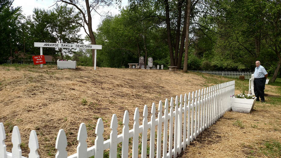 Dick Kopple stands next to the refurbished Arrance family cemetery.