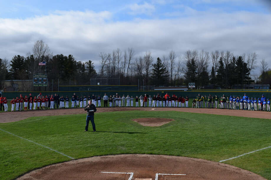 Courtesy of John Szajenko All six majors teams line up at the start of opening day for the Fraternal Northwest Little League on Tuesday at Sturgeon Fields. Photo: Erin Kirkland/Midland Daily News
