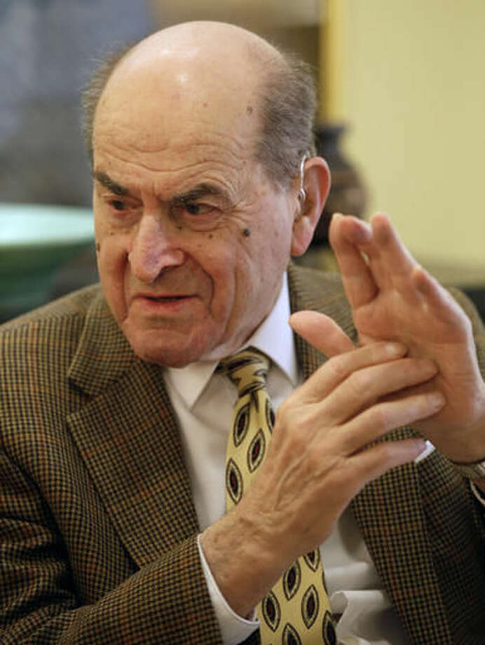 FILE - In this Feb. 5, 2014 file photo, Dr. Henry Heimlich describes the maneuver he developed to help clear obstructions from the windpipes of choking victims, while being interviewed at his home in Cincinnati. Heimlich recently used the emergency technique for the first time himself to save a woman choking on food at his senior living center. Heimlich said Thursday, May 26, 2016 that he has demonstrated the well-known maneuver many times through the years but had never before used it on a person who was choking. (AP Photo/Al Behrman) Photo: Al Behrman