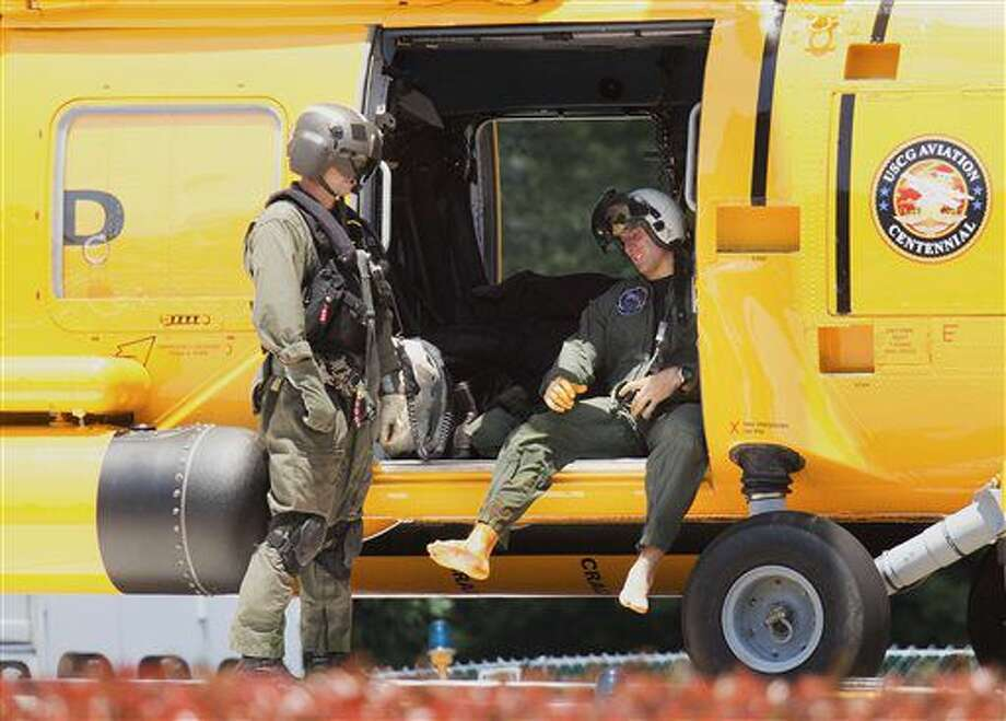 A Navy aviator involved in a crash waits to exit ta coast guard helicopter at Sentara Norfolk General Hospital in Norfolk, Va. Thursday, May 26, 2016. Two Navy jet fighters collided off the coast of North Carolina during a routine training mission on Thursday, sending several people to the hospital, officials said. (L. Todd Spencer/The Virginian-Pilot via AP) MAGS OUT; MANDATORY CREDIT Photo: L. Todd Spencer