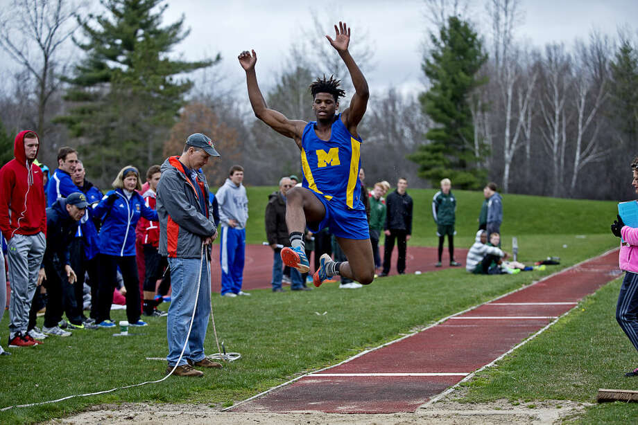 Midland High's Vince Walker competes in the long jump during the Graves/Swayze track meet on Friday at Northwood University. Photo: Erin Kirkland/Midland Daily News