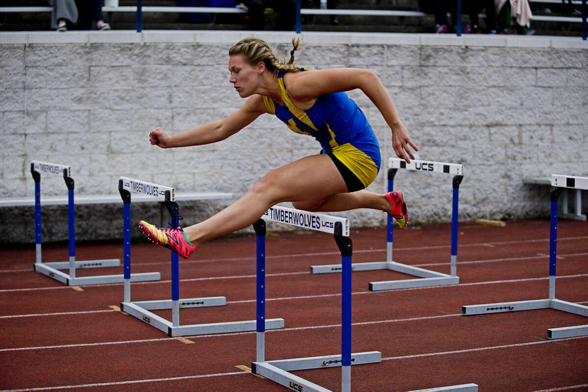 ERIN KIRKLAND | ekirkland@mdn.net Midland's Rebekah Walter competes in the 110 m shuttle hurdle relay during the Graves/Swayze track meet on Friday at Northwood University.