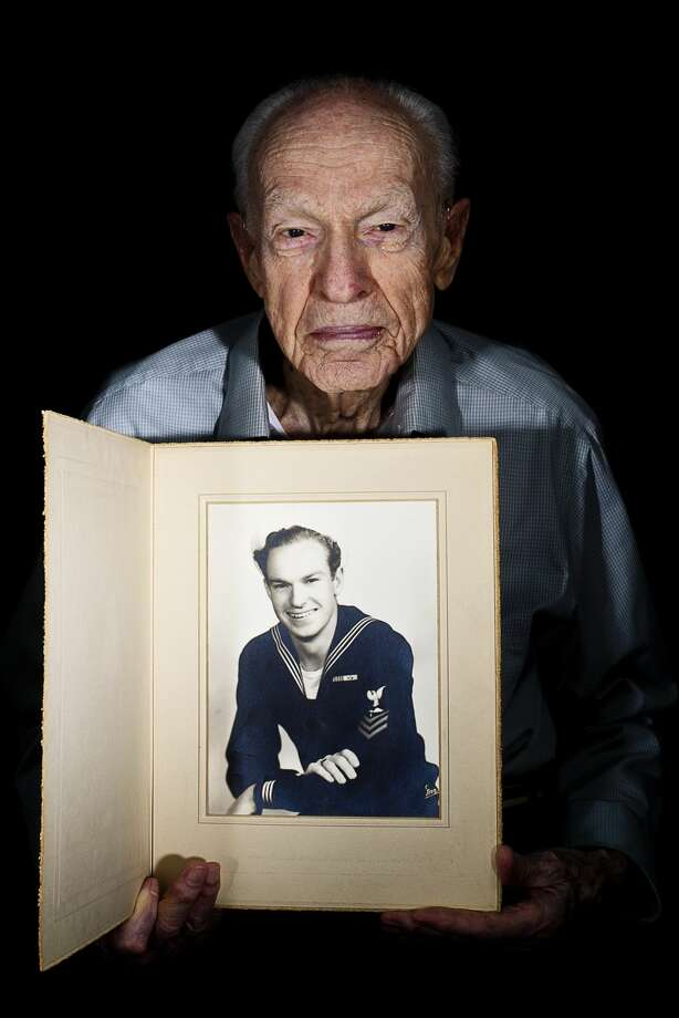 WWII Navy veteran Petty Officer 1st Class Charles Campbell holds onto a photo of himself on Wednesday, May 11 at Independence Village. Campbell was stationed in the South Pacific, and this photo was taken the day after he got out of the service -- two days later his first child was born. Photo: Erin Kirkland/Midland Daily News