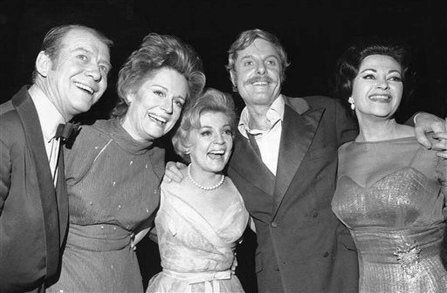 "FILE - In this April 4, 1971 file photo, stars of the show ""Follies,"" from left, Gene Nelson, Alexis Smith, Dorothy Collins, John McMartin, and Yvonne DeCarlo pose in New York. McMartin, the silver-haired, Tony Award-nominated actor whose Broadway career spanned decades, died of cancer, Wednesday, July 6, 2016, in New York. He was 86. (AP Photo/Ron Frehm, File) Photo: Ron Frehm"