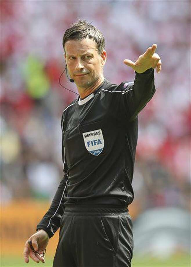 FILE - In this Saturday, June 25, 2016 file photo, referee Mark Clattenburg directs the Euro 2016 round of 16 soccer match between Switzerland and Poland, at the Geoffroy Guichard stadium in Saint-Etienne, France. English official Mark Clattenburg will referee the Euro 2016 soccer final between France and Portugal scheduled for Sunday, July 10, 2016 at the Stade de France in Saint-Denis, north of Paris. (AP Photo/Thanassis Stavrakis, File) Photo: Thanassis Stavrakis